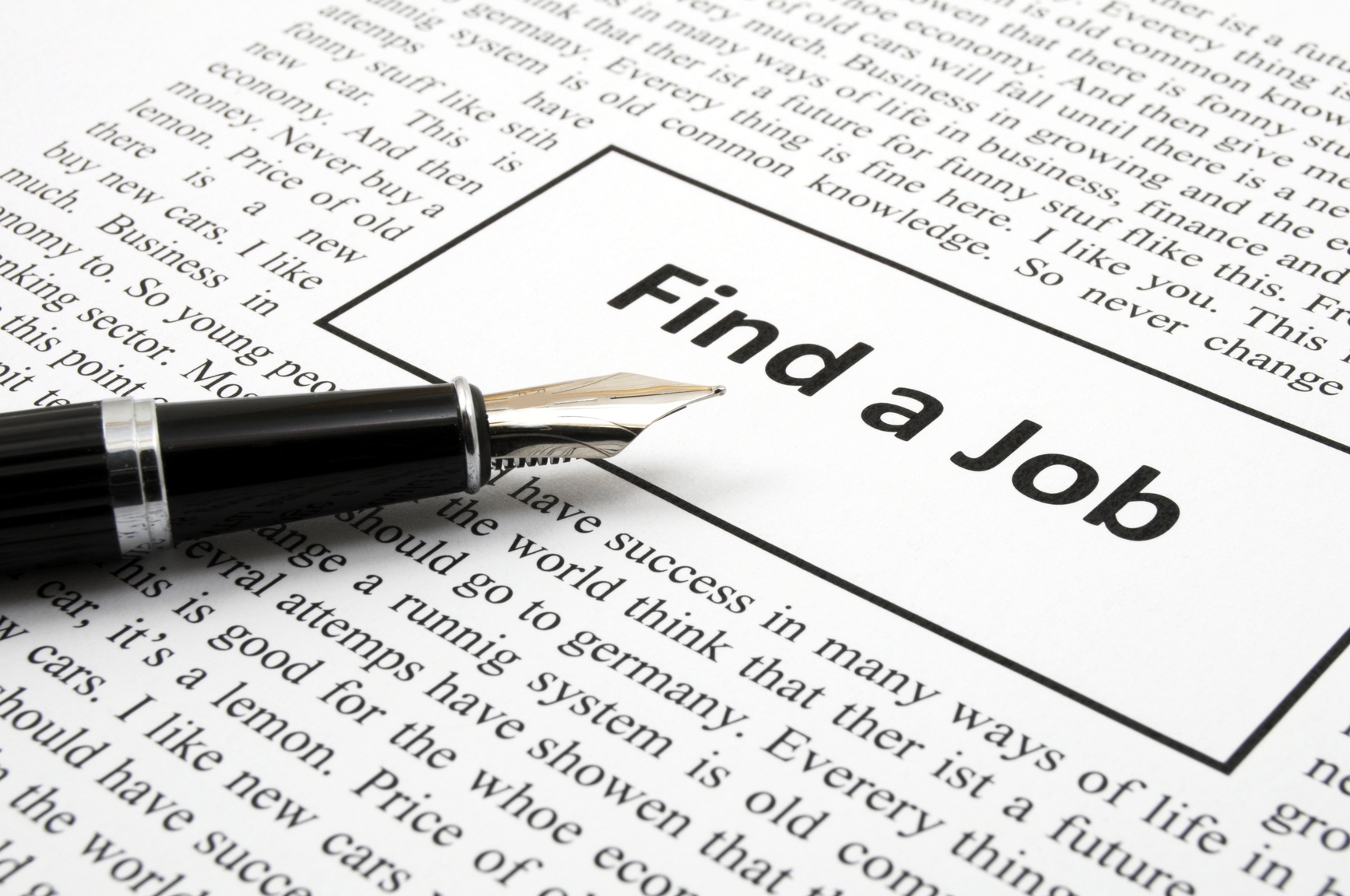 find a job in newspaper showing unemployment concept